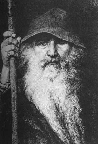 This black and white image of the Norse god Odin shows a one-eyed white man with a long white beard wearing a floppy hat and holding a cane.