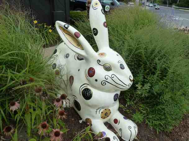 The Regal Rabbit is a giant fiberglass rabbit covered with swirly lines, circles, and glitter.
