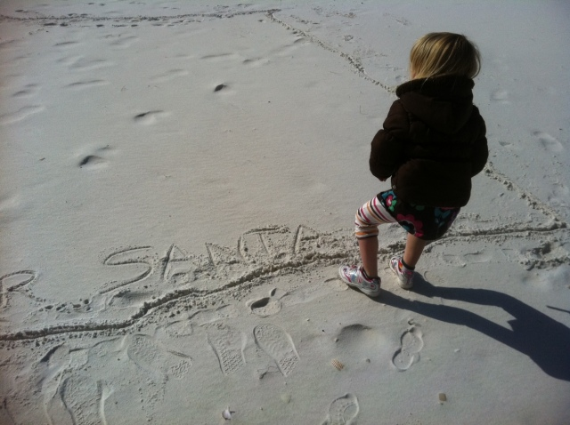 The then Four-Year-Old inspecting her work on Santa's landing pad last Christmas Eve. (Photo: Shala Howell)