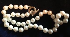 The Five-Year-Old's favorite pearl necklace. It's not made from mummified parasites, but rather glass, wax and essence d'orient, which turns out to be a pearly coating made from fish scales. (Photo: Shala Howell)