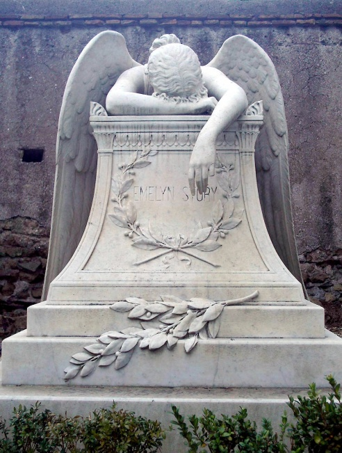 Angel of grief, a 1894 sculpture by William Wetmore Story. The sculpture serves as the gravestone of the artist and his wife Emelyn at the Protestant Cemetery, Rome. (Photo: LuciusCommons via Wikipedia)
