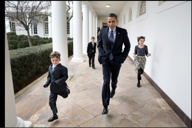President Barack Obama races Deputy National Security Advisor Denis McDonough's children on Jan 25, 2013 at the White House. No doubt to see who gets to read Caterpickles first. (Official White House Photo by Pete Souza)