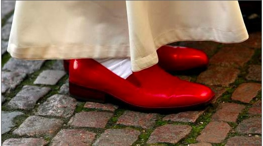 Even though I know there's a long-standing tradition of the Pope wearing red leather shoes outside, this picture always makes me think of Dorothy in the Wizard of Oz. (Photo of Pope Benedict wearing his red papal shoes via SkyNews)