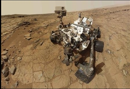 A portion of Mount Sharp, on Mars is pictured in this panorama made from a mosaic of images taken by the Mast Camera (Mastcam) on NASA's Mars rover Curiosity September 20, 2012 and released as a NASA handout image March 15, 2013. The photo has a white-balanced color adjustment that makes the sky look overly blue but shows the terrain as if under Earth-like lighting. (Photo: NASA/JPL-Caltech/MSSS)
