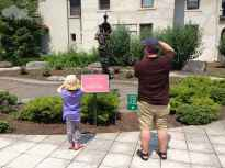 Father and five-year-old daughter taking a photo in the Seuss Garden.