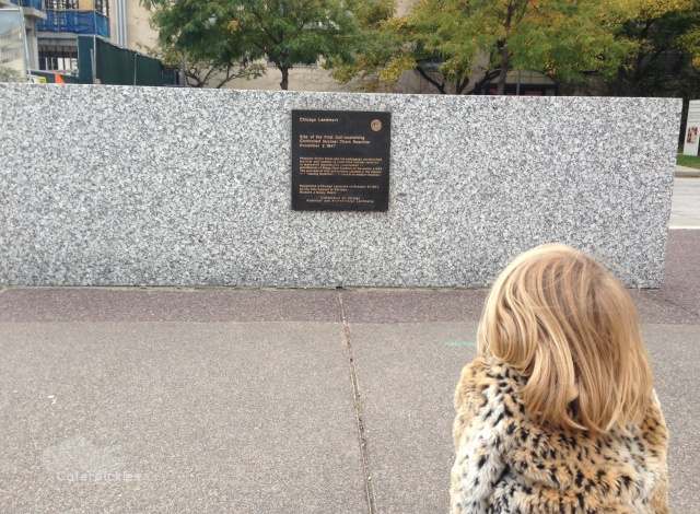 The Six-Year-Old studies a sign on the University of Chicago campus. (Photo: Shala Howell)