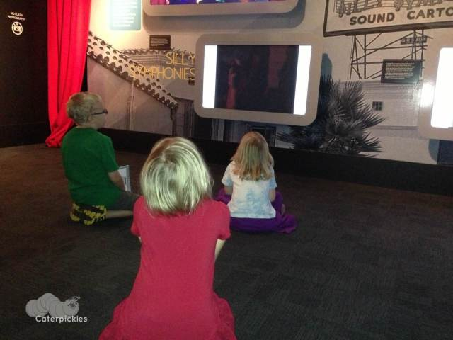 The Six-Year-Old and her buddies watch a short film at the Disney exhibit at the Museum of Science & Industry. (Photo: Shala Howell)