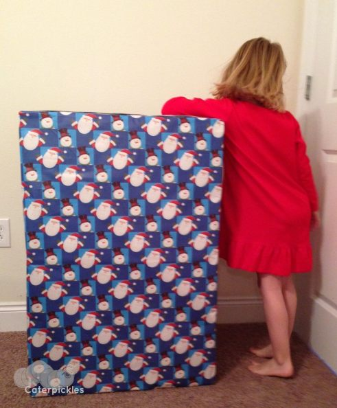 Can you blame her? How can you not want to know what's in that box? (Photo: Shala Howell)