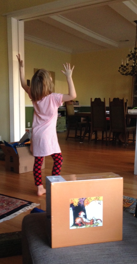 The Eight-Year-Old, celebrating the arrival of her new Calvin & Hobbes box set. (Photo: Shala Howell)