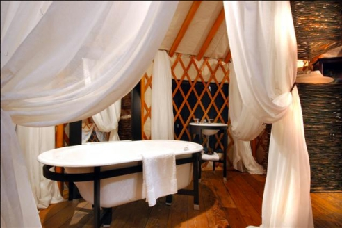 Yurts can even feature indoor plumbing. Fancy that. (Photo: Yurts by Design)