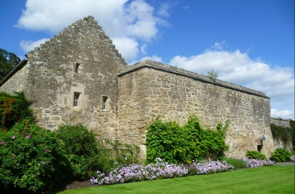 Ancient stone building with lovely gardens.