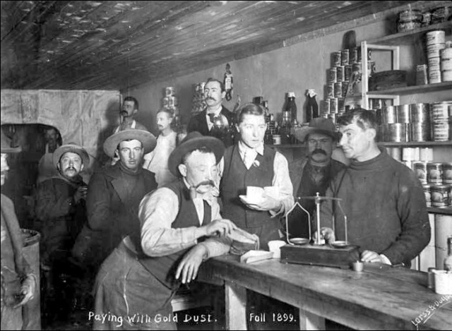 Paying for supplies with gold dust. (Photo from the Klondike Gold Rush, 1899).