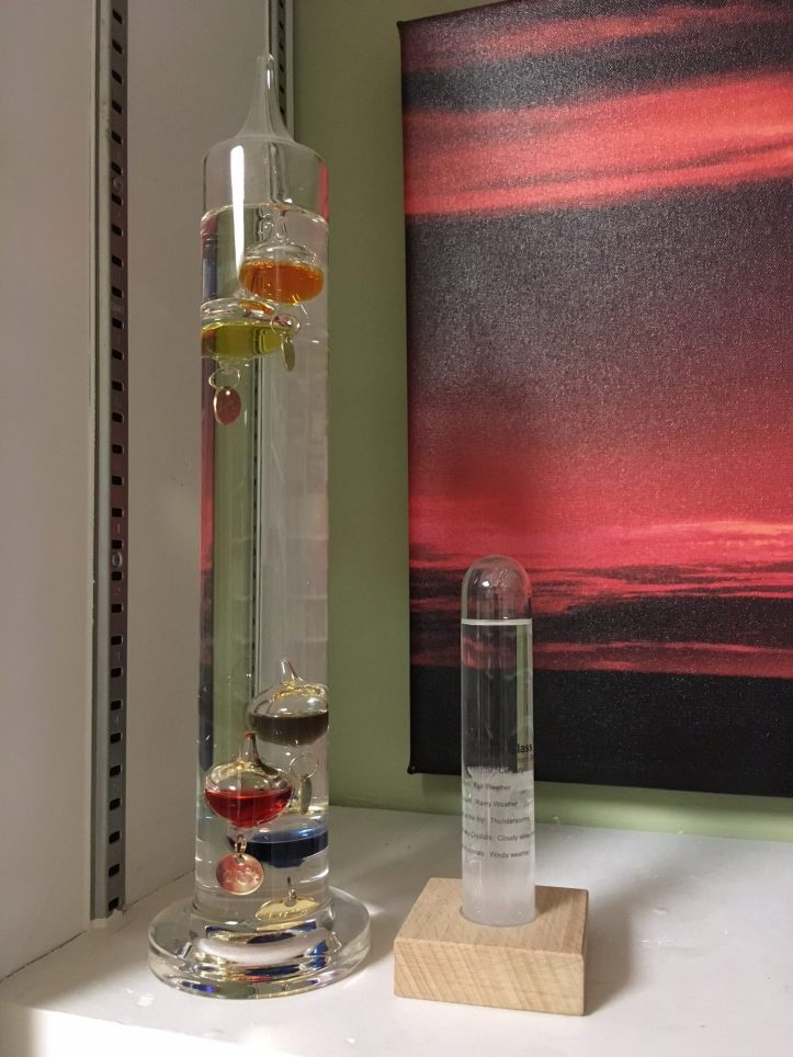 My retro weather center. The storm glass is on the right, making its bold prediction of cloudy skies in Chicago in winter. The glass tube on the left is Galileo's thermometer. We'll talk about how/if that sucker works some other time. (Photo: Shala Howell)