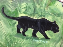 the black panther stalks over a green background