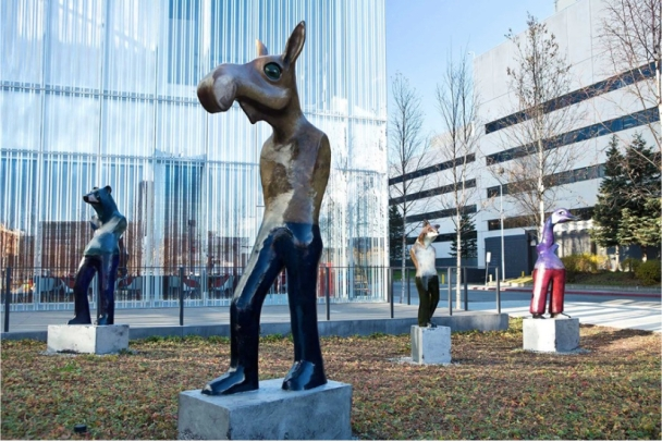 Statue of a moose standing like a man in front of Anchorage Art Museum.