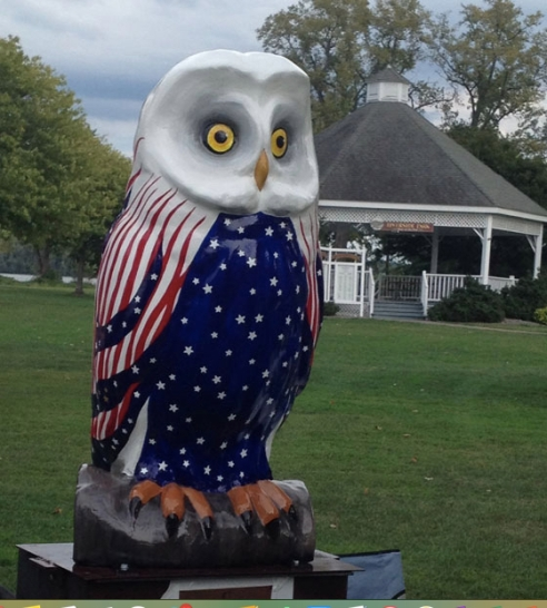 The Freedom owl is painted red, white, and blue, naturally. The owl's head is white, his wings striped red and white, and his blue belly is full of white stars.