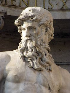 Marble statue of a heavily bearded man, done in the Classical Greek style.