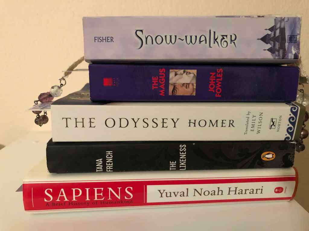 Five more books: The Snow-walker by Catherine Fisher, The Magus by John Fowles, The Odyssey translated by Emily Wilson, The Likeness by Tana French, and Sapiens by Yuval Noah Harari.
