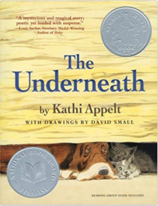 book cover for The Underneath shows a basset hound huddled with a family of cats under a wooden building