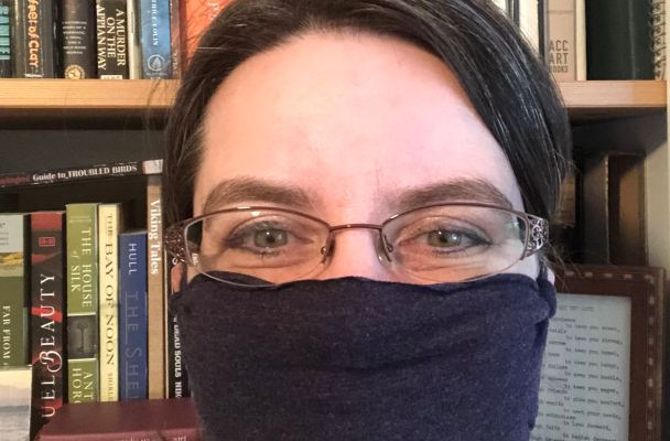Photo of me wearing a no-sew mask made from one of my husband's old t-shirts.