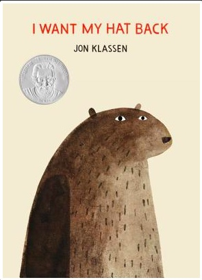 Book cover for I want my hat back by Jon Klassen shows a large brown hatless bear on a cream background.
