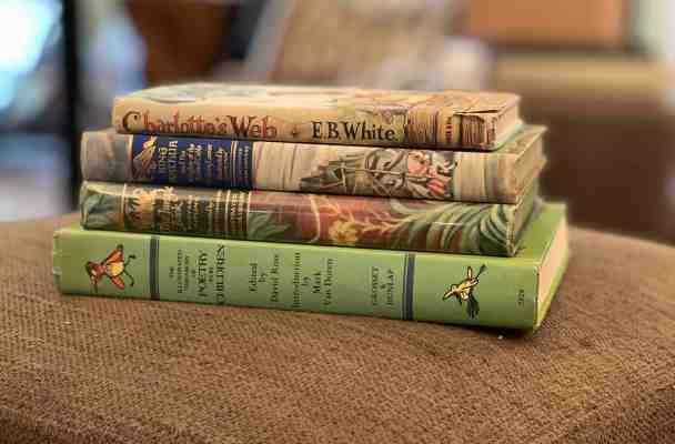 Pile of hardback books, including Charlotte's Web, King Arthur and the Knights of the Round Table, The Jungle Book, and The Illustrated Treasury of Poetry for Children.